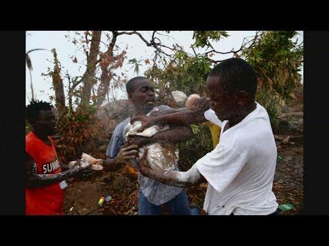 Desperate Haitians loot U.N. aid trucks