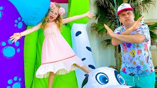 Nastya does a dress up and jumps on a kids trampoline