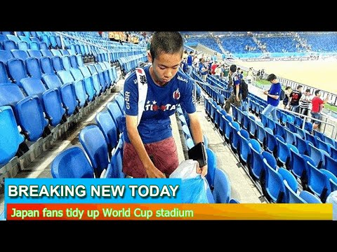Breaking News - Japan fans tidy up World Cup stadium