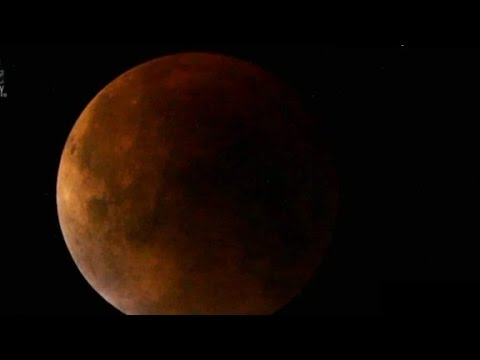 Supermoon lunar eclipse seen above Earth