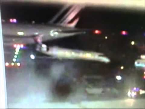 Air France Jumbo Jet hits smaller plane at JFK Airport - April 11, 2011