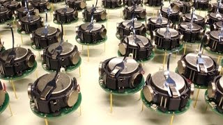 "Self-assembly of thousand little robots ""Kilobots"" to form complex shapes."