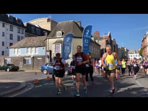 Car prepares to drive through Half marathon in Plymouth