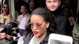 Rihanna surrounded by fans as comes out of Avenue restaurant in Paris