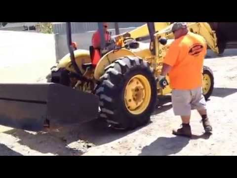 Tractor tears up easy Eco pave with difficulty - natural pa