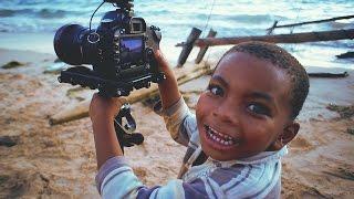 Kids playing with my cameras in Madirokeli Beach, Madagascar! Faceb...