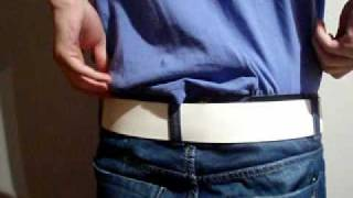 Young boy sagging in jeans and white leather belt