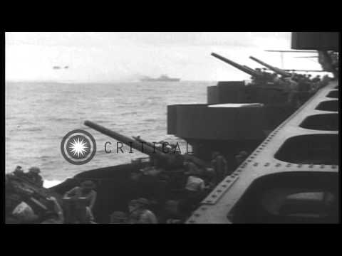 US Navy personnel fire AA guns and USS Lexington (CV-2) underway and hit during B...HD Stock Footage