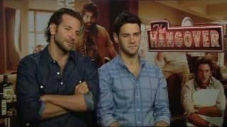 Bradley Cooper and Justin Bartha Nurse The Hangover | Empire Magazine