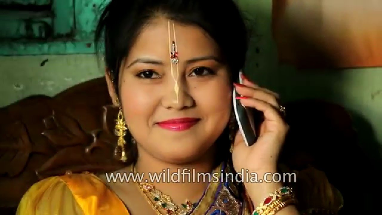 Manipuri bride speaks to friends on her mobile, before her wedding ...