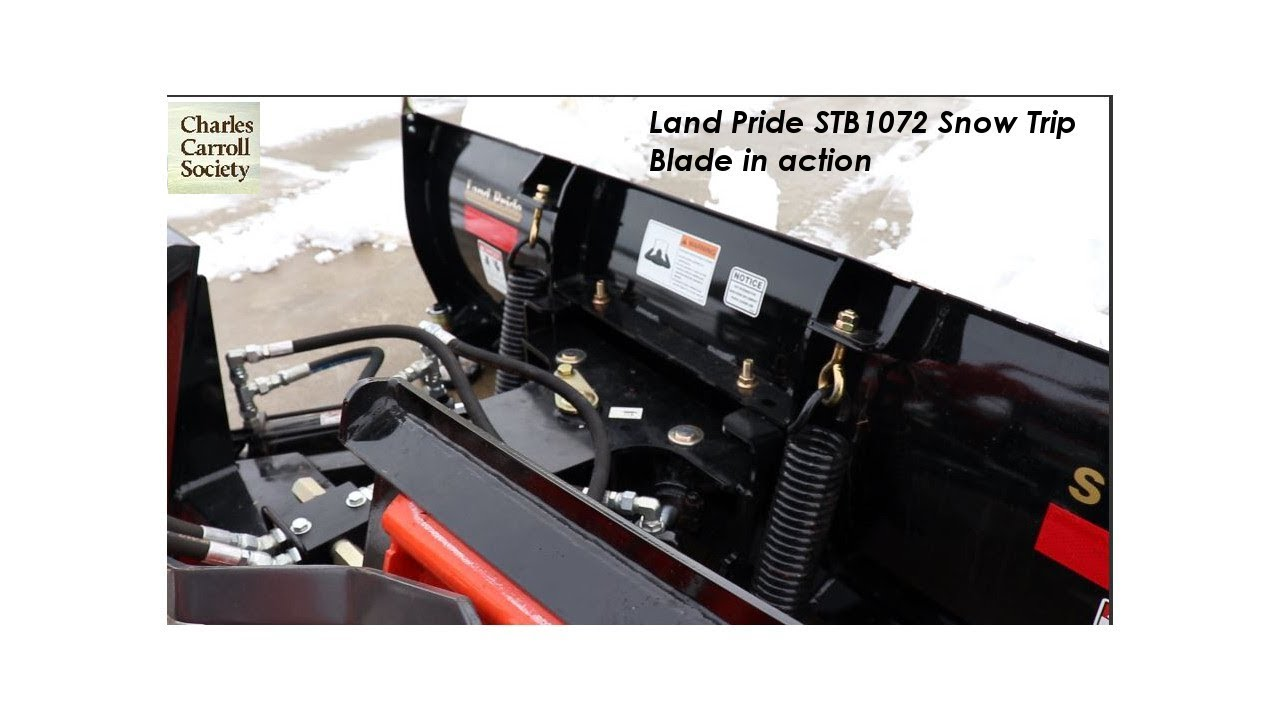 The Land Pride STB1072 Snow Trip Blade in Action with the Kubota B3350