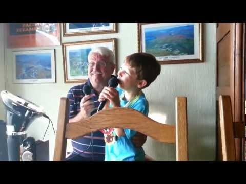 Marco and Nino sing at the Auberge du Coq de Montagne