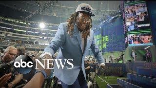 NFL draft pick celebrating an unbelievable triumph against the odds