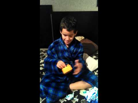 Young boy Opening his present...