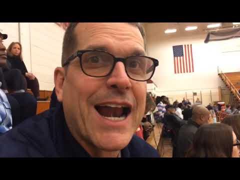 Jim Harbaugh talks about Josh Gattis during their recruiting visit to Muskegon