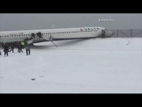 Plane Crashes Through Fence at LaGuardia Airport