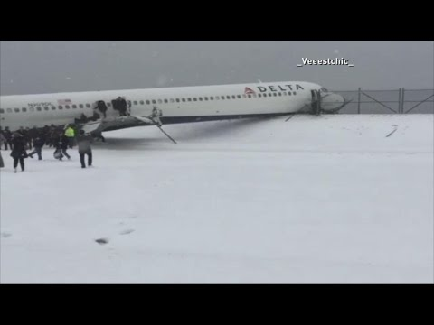 Plane Crashes Through Fence at LaGuardia Airport