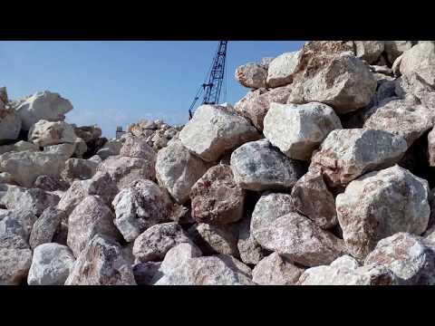 Building new wavebreakers at Geroskipou beach in Paphos