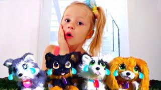 Nastya finge brincar com cachorros de brinquedo