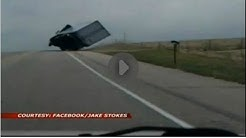 Tractor trailer driver avoids flipping over.