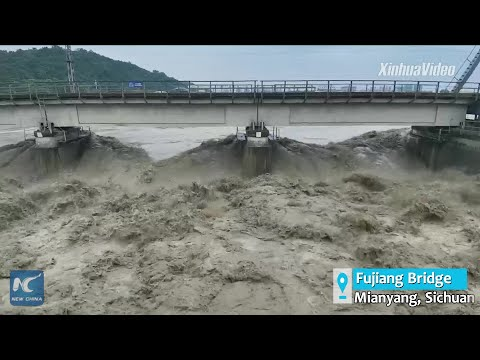 Heavy-haul freight trains pulled on SW China's bridge to thwart flood impacts
