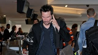 Keanu Reeves Takes A Call And Avoids The Paps At LAX