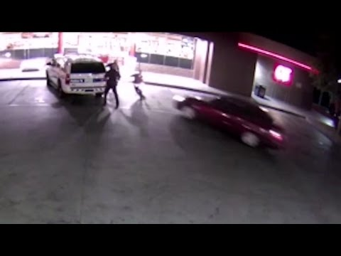 WATCH: Driver slams car into Phoenix police officers in parking lot