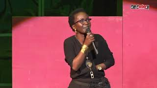 Kansiime sings at comedicine. African entertainment.