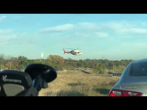 Helicopter lands in middle of highway Leaving Texas motor speedway