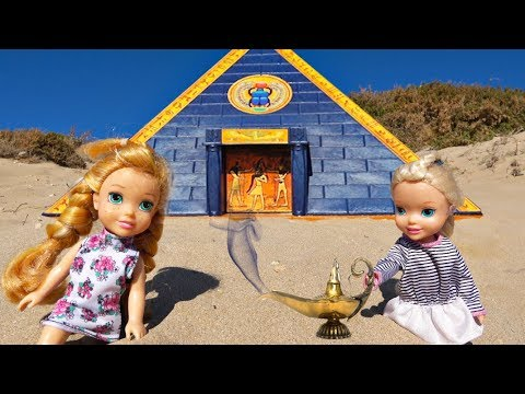 Elsa and Anna toddlers find a treasure in a pyramid