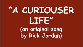 """A Curiouser Life"" words & music by Rick Jordan 08/05/2012 friskier version"