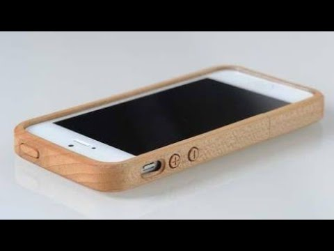 A wonderful backcover for I phone 5s😍😍 Made by wood and attach some gadgets 😍😍😍
