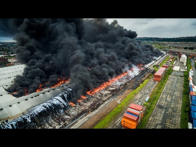 We flew a drone above the mass destruction of the Durban warehouse fire still burning