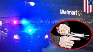 スーパー店内で男が銃を構える
