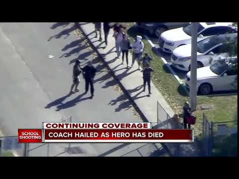 Coach dies after shielding students from gunfire in Florida school shooting