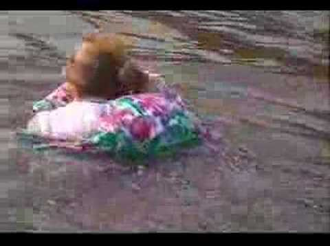 Woman swimming in her skirt