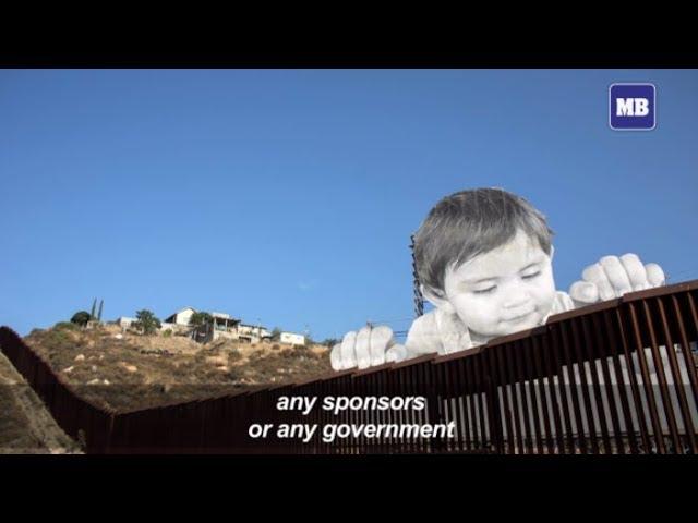 "A child's innocence: ""Kikito"" looks over US wall from Mexico"