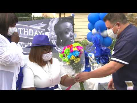 Woman shot in head stray bullet celebrates birthday with officers who saved her