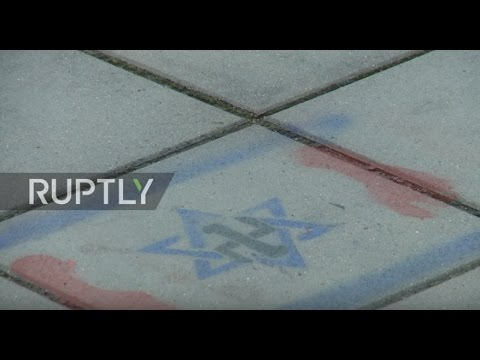 Poland: Nazi and Jewish symbols graffitied on Soviet Military Cemetery in Warsaw
