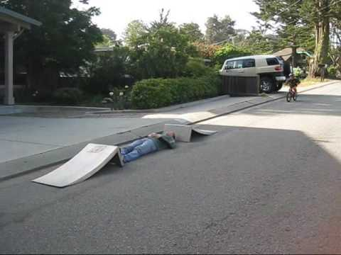 OMG!!! 5 yr old kid bike jumps 10ft over his Dad!!!
