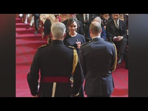 Victoria Beckham receives an OBE from Prince William for services to fashion