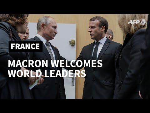 Macron welcomes world