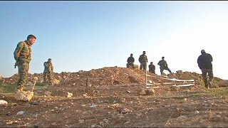 Yazidi return home to find mass graves