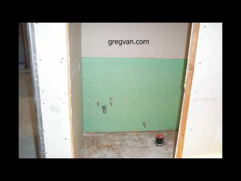 green-wallboard-behind-toilet-and-bathroom-cabinet---home-building-tips