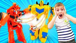 Видео про игры Трансформеры. Новые бластеры Бамблби. Игрушки для мальчиков - Автомастерская и роботы