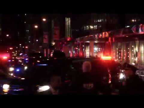 Trump Motorcade Envoy rolling by Trump Tower
