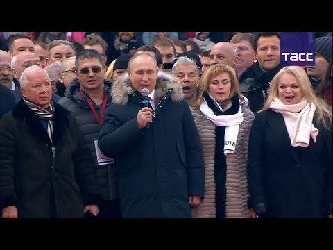 Путин исполнил гимн России вместе со спортсменами в