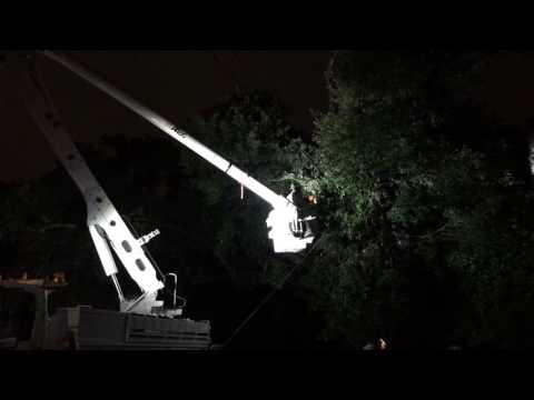 Watch Entergy crews repair a power line after Sunday's storm