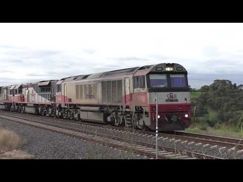 SCT Trains A Lengthy Brisbane to Melbourne Freight BM9 at Airport West