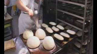 Bakerman is baking bread - a master baker at work
